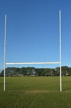 rugby field: Rugby field and goalposts against blue sky.