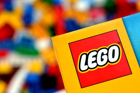 lego: AUCKLAND, NZ - MAR 11 2014:Illustrative editorial photo of Lego logo .The LEGO bricks of today still fit perfectly with the one that was created more than 50 years ago in 1958.