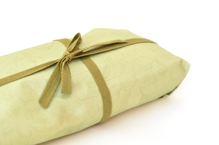 life events: Olive green gift box with dark green ribbon and bow on white background. Cut off with copyspace.Concept photo of birthday, holidays, life events, wedding and special occasion