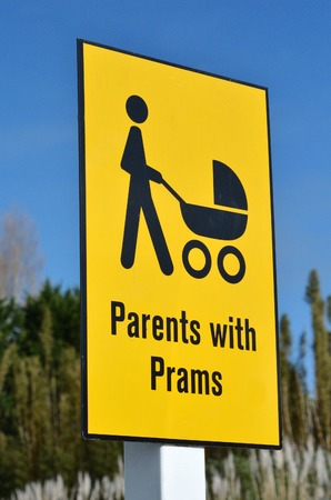 fatherhood: Detail of a signpost marking a parking area especially for people with babies. Concept photo of  parenthood, motherhood, fatherhood, childhood, baby