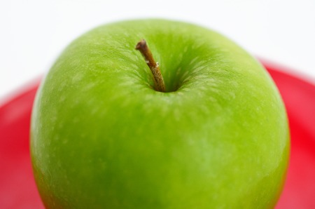jewish holiday: Fresh green apple for Rosh Hashanah Jewish holiday, on white background with copy space Stock Photo