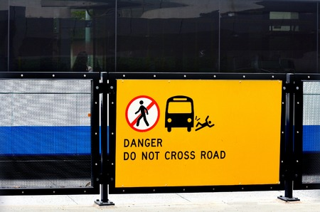do not cross: Danger do not cross road sign and symbol. concept photo