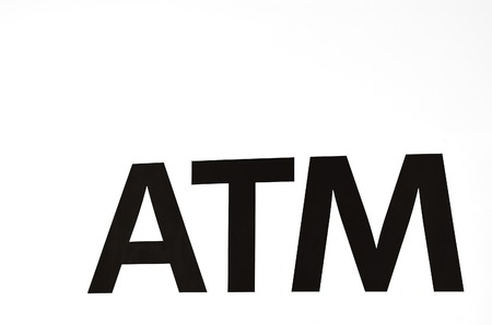 automated teller machine: ATM sign isolated on white background. Automated teller machine sign in front of a bank. Concept photo of bank, banking finance , economy and money. BW