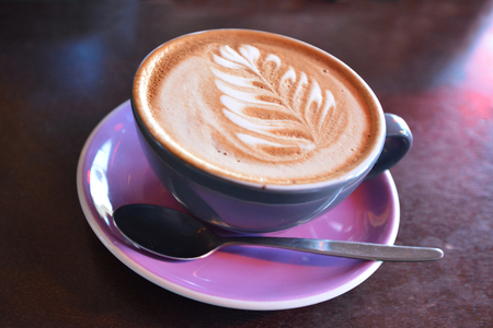 silver fern: Flat white coffee decorated with the New Zealand iconic symbol the silver fern on it. Copy space