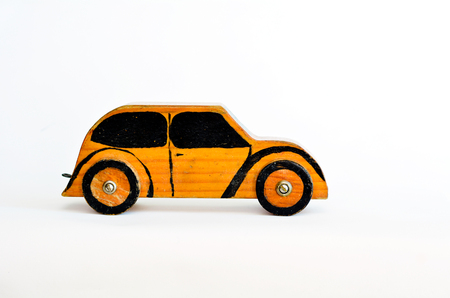 safe driving: Toy car isolated on white background with copy space.Concept photo of car business, car Insurance, auto dealership,car rental ,safe driving ,buying, renting, fuel, service and repair costs Stock Photo