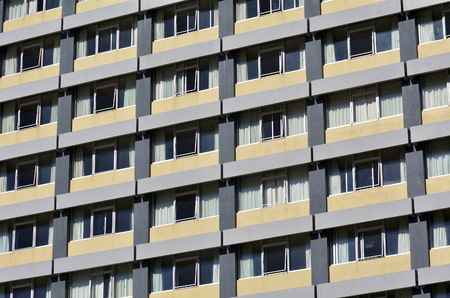 condominium complex: A facade of apartment building. concept photo of house, housing, market, real estate,property, rent, buy, economy, lifestyle,living, life. Stock Photo