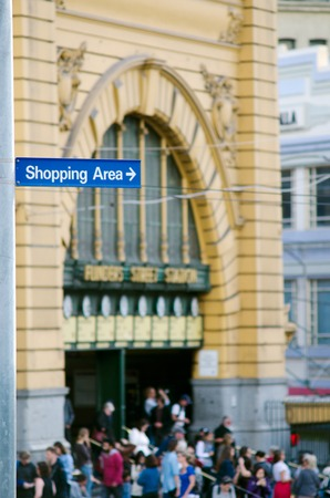retail shopping: Shopping Area street sign above Flinders Street Station at Melbourne CBD Victoria, Australia.