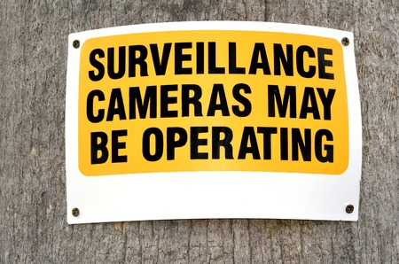 electronic survey: Surveillance cameras sign in the street reads: Surveillance cameras may be operating. concept photo of security, crime, criminality. Stock Photo
