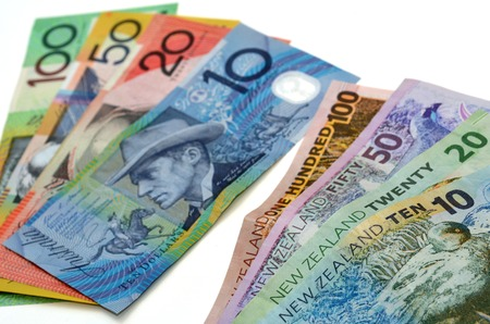 australian dollar notes: New Zealand Dollar bank notes and Australian Dollar banknotes. Concept photo of money, banking ,currency and foreign exchange rates.  (Isolated on white background)