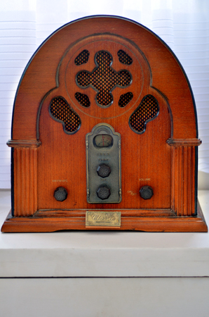 old time: An old time classic radio on wooden shelf.