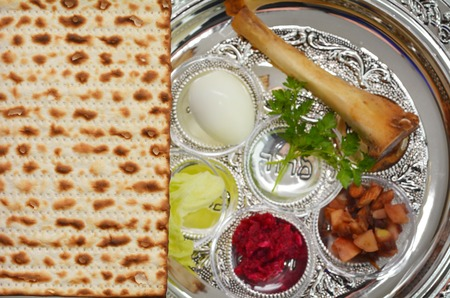 jewish holiday: Matzo bread next to Passover Seder Plate with The seventh symbolic item used during the seder meal on passover Jewish holiday. Stock Photo