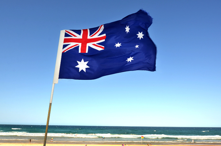 australian landscape: The National flag of Australia flay over the Gold Coast in Queensland, Australia. Stock Photo