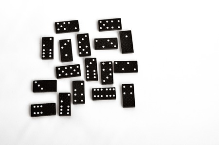 Domino effect concept scattered domino tiles on white background.copyspace (BW) Stock Photo