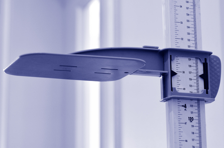 human height: Stadiometer - human height measuring devices. close up. Concept photo of medical, lifestyle, height and growth.