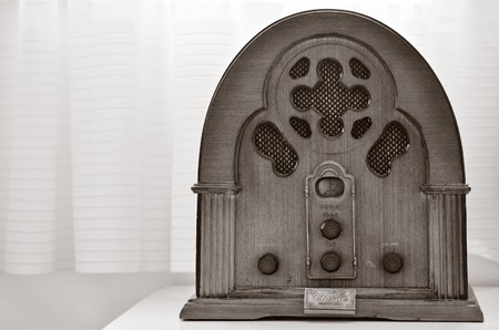 An old time classic radio on wooden shelf. (WB)