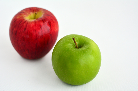 jewish holiday: Fresh green and red apples for Rosh Hashanah Jewish holiday, on white background with copy space