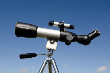 Telescope on tripod isolated on blue sky. Concept photo of exploration,  discover, discovery,view, vision, lifestyle, look, looking, spy, spying, search, searching. Stock Photo