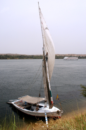 nile river: A Felucca sails on the Nile river near Aswan, Egypt. Editorial