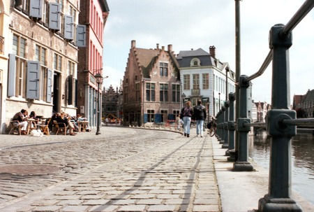 People walking by the river Gent in Gent, Belgium. Stock Photo