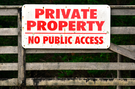 no access: Private Property, No Public Access No entry sign on a gate in Waiheke Island, New Zealand.