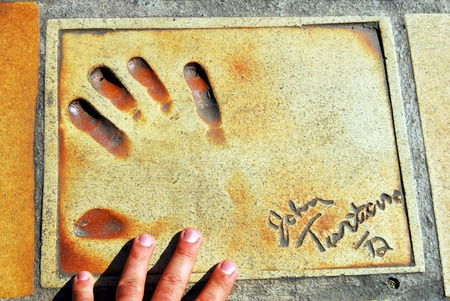 imbedded: Handprints of movie and film stars (John Tarantino ) in Cannes, France.
