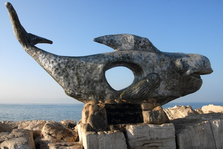 Statue of a whale at the historic port of Acre in Akko ,Israel.