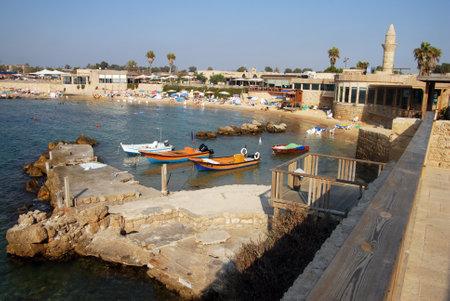 caesarea: CAESAREA - AUGUST 23: Fisherman boats in Caesarea ancient port on August 23 2007 in Caesarea, Israel. Editorial