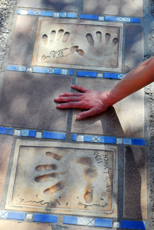 imbedded: Handprints of movie and film stars (David Lynch) in Cannes, France.