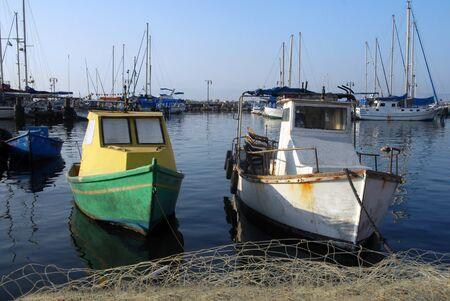 holyland: An old fishing boat mooring at ancient Akko Port in Acre (Akko) Israel.