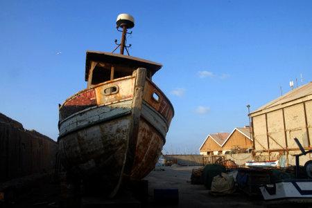 yaffo: An old fishing boat in ancient Yaffo Port Israel in Tel Aviv, Israel.
