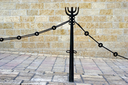 western wall: A pole with a Jewish menorah symbol decoration at the Western wall in Jerusalem, Israel.