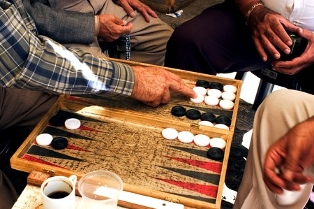 JERUSALEM - SEPTEMBER 10: People plays backgammon game on September 10 2005 in Jerusalem, Israel.Backgammon is one of the oldest board games for two players in the world. Editorial
