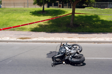total loss: A Motorbike accident on a road is taped off by police Stock Photo