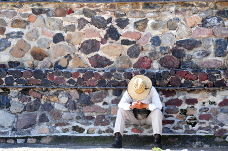 Mexican man has a siesta at the bottom of a pyramid in Teotihuacan, Mexico. Stock Photo