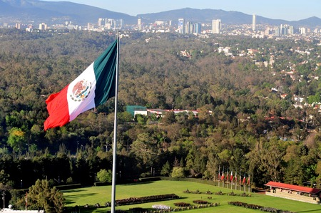 mexico city: A giant Mexican national flag above Mexico City, Mexico.