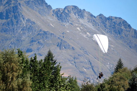 skydiving: Extreme skydiving above Lake Wakatipu, Queenstown, south Island, New Zealand. Stock Photo
