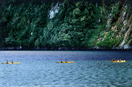 mitre: Canoeing on Fiordland national park in southern New Zealand.