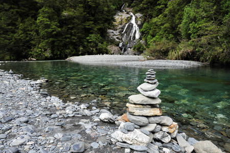 aspiring: Stacks of rocks at Fantail Falls at the trailhead for Mt. Brewster at the Haast Pass road on New Zealand's South Island. Stock Photo
