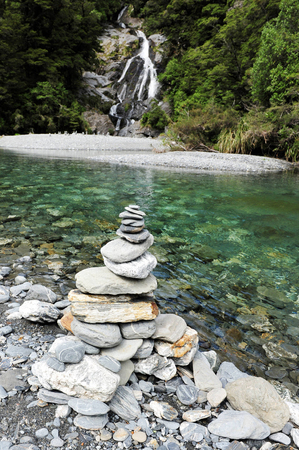fantail: Stacks of rocks at Fantail Falls at the trailhead for Mt. Brewster at the Haast Pass road on New Zealand's South Island.