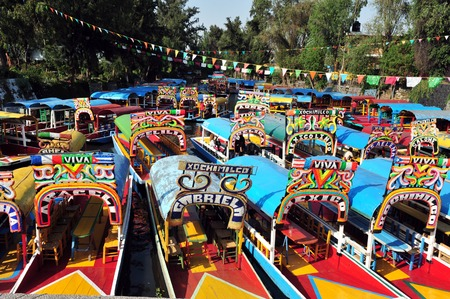 city: Colourful Mexican gondolas at Xochimilcos Floating Gardens in Mexico City.