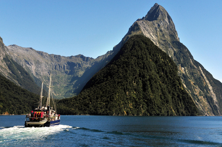 mitre: Ship sail under Mitre Peak in Fiordland National Park, southern Island, New Zealand.