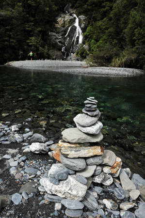fantail: Stacks of rocks at Fantail Falls at the trailhead for Mt. Brewster at the Haast Pass road on New Zealand's South Island. Stock Photo