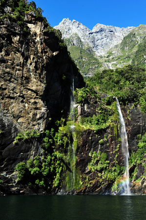 fiordland: Landscape view of tall waterfalls in Fiordland, southern New Zealand. Stock Photo