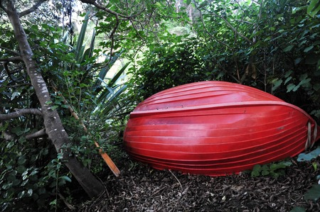 dingy: A red dingy boat in Waiheke Island NZ.