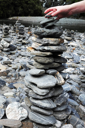 fantail: Stacks of rocks at Fantail Falls at the trailhead for Mt. Brewster at the Haast Pass road on New Zealands South Island. Stock Photo