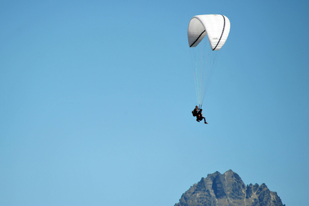 Tandem: Two men tandem skydive with blue sky  Stock Photo