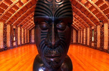 treaty: Interior view of the Maori carvings inside a meeting house (Marae) near the Treaty House in Waitangi, New Zealand.