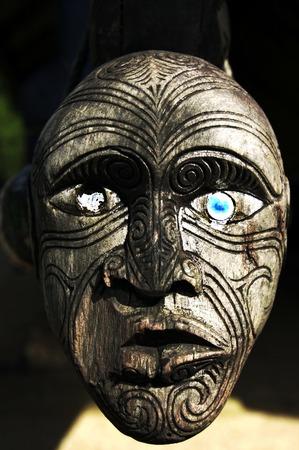 aotearoa: Traditional Maori wall carvings in a Marae meeting house New Zealand.