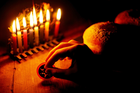 observed: Candles on a menorah for the Jewish holiday Hanukkah that is observed for eight nights and days.