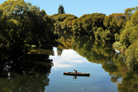 fishing lake: Fishing in the south island of New Zealand. Stock Photo